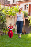 Mother and toddler walk Stock Photography