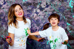 Mother together with a daughter is shown with palms soiled with. Happy girls in the paint Stock Photo