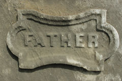 Mother Tombstone Detail Concrete. `Father` detail from an old tombstone in a historic cemetery. Useful as a design element Royalty Free Stock Photos