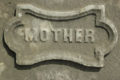 Mother Tombstone Detail Concrete. `Mother` detail from an old tombstone in a historic cemetery.  Useful as a design element Stock Images