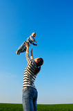 Mother tossing up her little boy Royalty Free Stock Photo