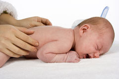 Mother touching baby's skin Stock Images