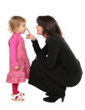 Mother touchs daughter's nose Royalty Free Stock Image