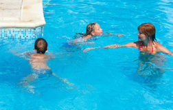 Mother train children to swim in the pool. Stock Photo