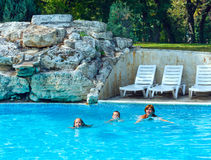 Mother train children to swim in the pool. Royalty Free Stock Photos