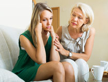 Mother tries reconcile with daughter royalty free stock photo