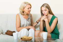 Mother tries reconcile with daughter Stock Photos