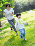 Mother tries to catch her son Royalty Free Stock Image