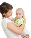 Mother trying to calm her crying baby isolated Stock Photos