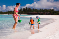 Mother and twin boys playing on the beach Royalty Free Stock Photography
