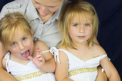 Mother and twin girls Stock Photography