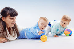 Mother with twins Stock Images