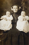 Mother and Twins Stock Images