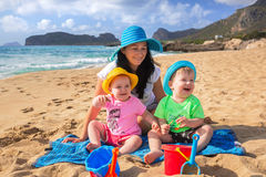 Mother with twins on sun holidays Stock Image