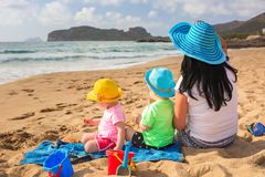 Mother with twins on sun holidays Stock Photos