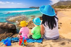 Mother with twins on sun holidays Royalty Free Stock Photo