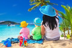 Mother with twins on sun holidays. Mother with twins on the tropical beach holidays stock images