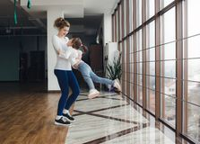 Mother twist her daughter in the gym Royalty Free Stock Photos