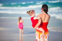 Mother and two adorable daughters walking at Royalty Free Stock Images