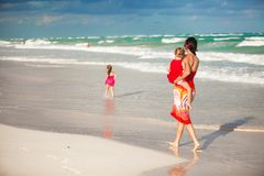 Mother and two adorable daughters walking at Stock Photo