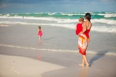 Mother with two adorable daughters walking at Stock Photography