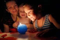 Mother and children looking at candle stock photography