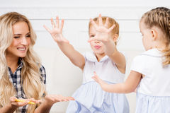 Mother with two beautiful daughters are drawing. Family, motherh Stock Photos