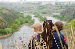 Mother with two boys enjoying a day in nature Stock Photo