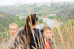 Mother with two boys enjoying a day in nature Stock Image