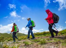 Mother and two boys hike royalty free stock images