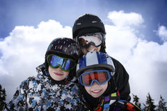 Mother with two boys skiing Royalty Free Stock Images