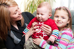 Mother and two children. A portrait of a young mother and two small girls.  Family portrait Stock Photography