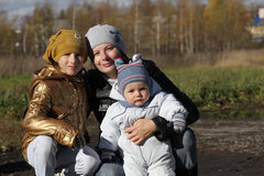 Mother and two children Stock Photos