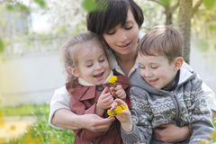 Mother and two children admiring spring garden Royalty Free Stock Images