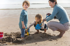 Mother and Two Children on the Beach Stock Images