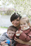 Mother and two children with Easter cake Stock Image