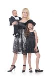 Mother and two children in formal clothes Stock Photos