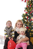 Mother and two children having fun at Christmas Royalty Free Stock Photos