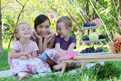 Mother and two children laughing Stock Photo