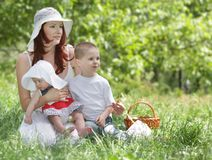 Mother and two children on nature Royalty Free Stock Photo