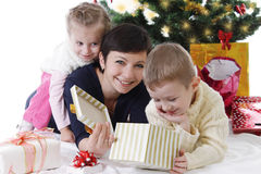 Mother with two children openning presents Royalty Free Stock Photos