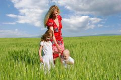 Mother and two children outdoors Royalty Free Stock Image
