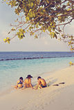 Mother with two children  relaxes on a beach Royalty Free Stock Photography