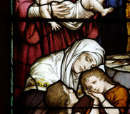 Mother with two children. A stained glass photo a Mother with two children Royalty Free Stock Image