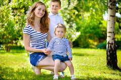 Mother with two children summer outdoors Stock Image