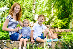 Mother with two children summer outdoors Stock Photos