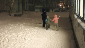 Mother with two children walking in the snow stock footage