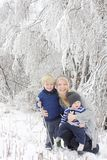 Mother and Two Children in Winter Wonderland Stock Images