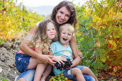 Mother with two childs boy and girl in vineyard Royalty Free Stock Photography