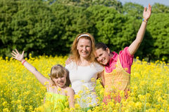 Mother and two daughter fun on meadow Royalty Free Stock Photo